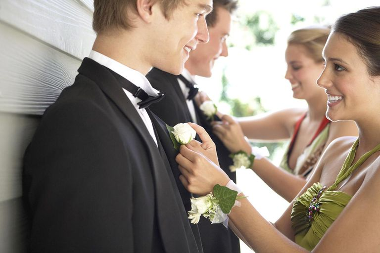 Young Women Pinning Boutonnieres on Prom Dates