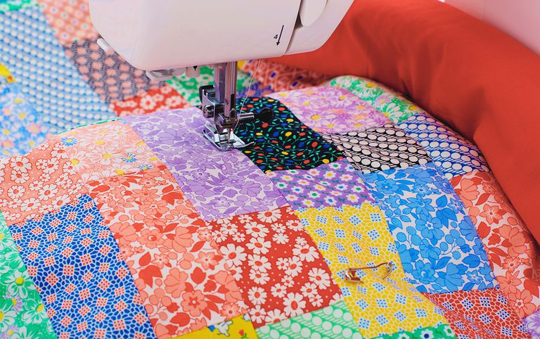 Sewing a colourful quilt