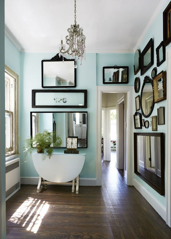 Hallway decorated in framed mirrors