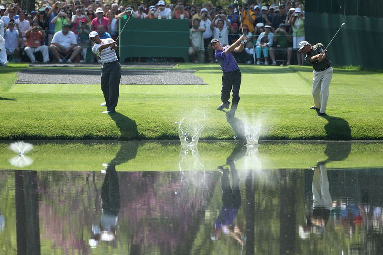 Tiger Woods, Jim Furyk and Fred Couples trying to skip their golf balls across the pond on Augusta National's 16th hole