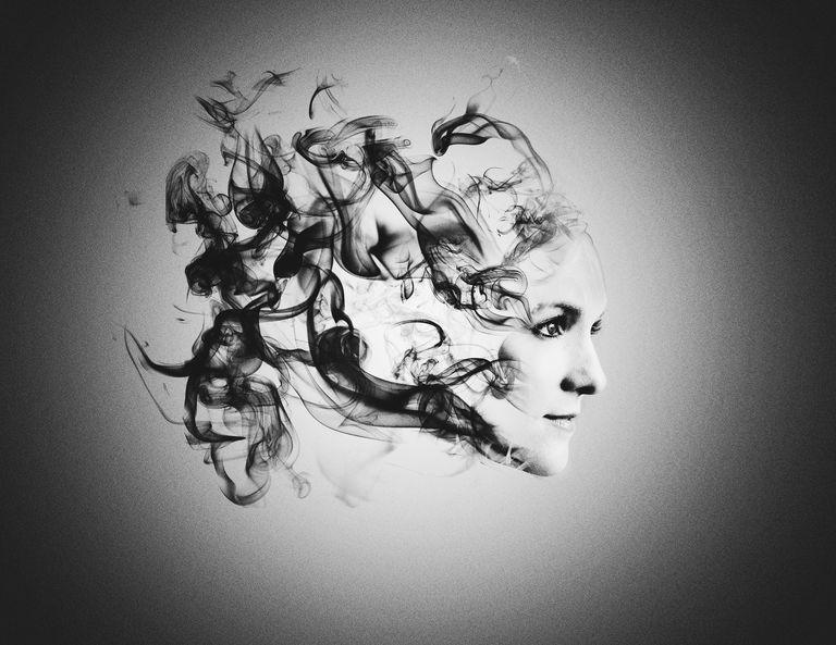 surreal smoke portrait of young woman