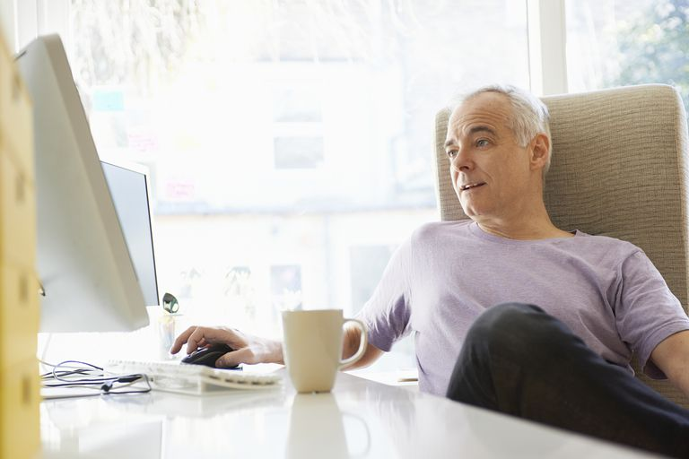 mature man working in home office - Working In Home Office