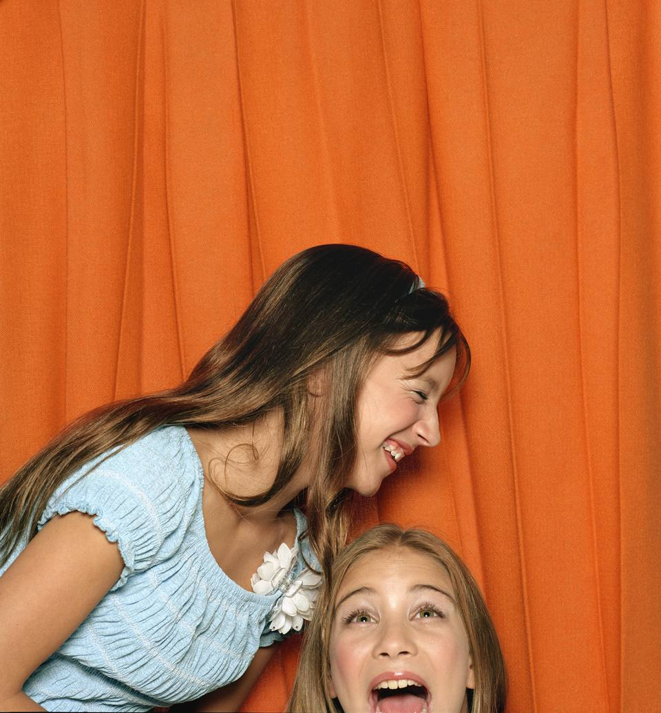 Two Girls Play in Photo Booth