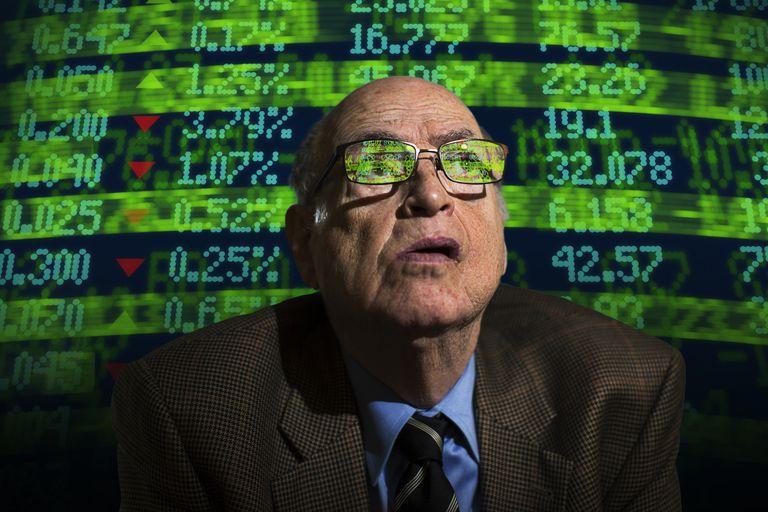 Portrait of anxious senior businessman evaluating P/E ratios.