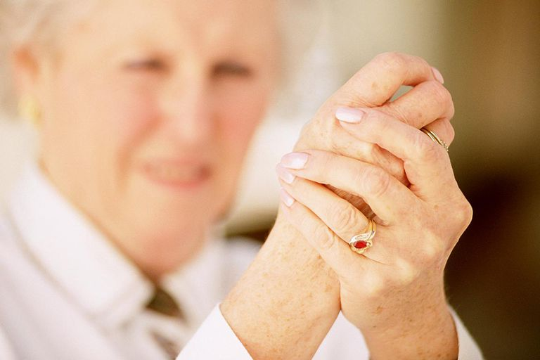 Older woman holding hand in pain