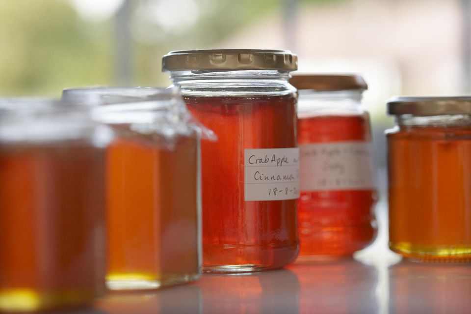 Jars of homemade jam in a row