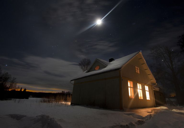 Winter Moon Over Snowy Cabin