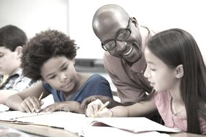 Teacher discussing classwork with students