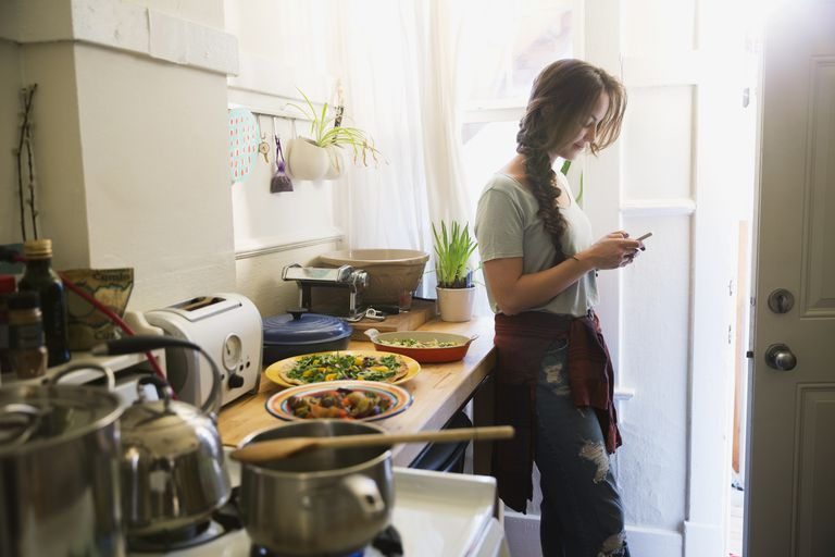 Woman cooking with phone app