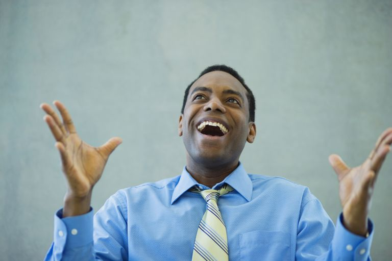 African businessman smiling and gesturing