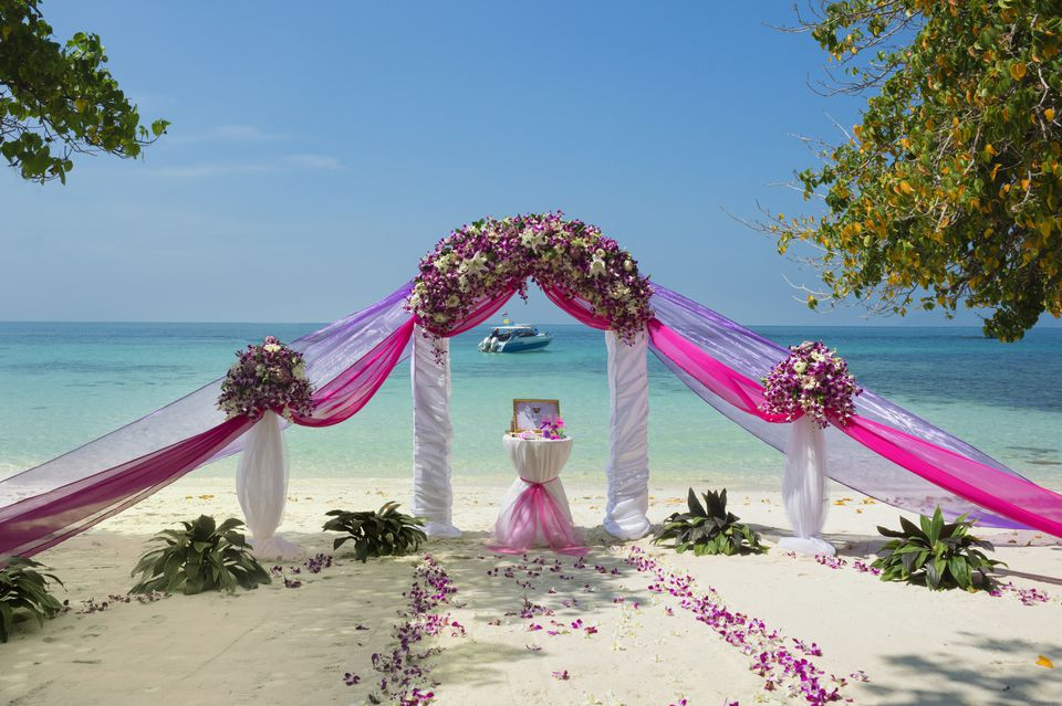 Outdoor wedding flower ideas for a beach wedding pink wedding flower altar on the beach junglespirit Images