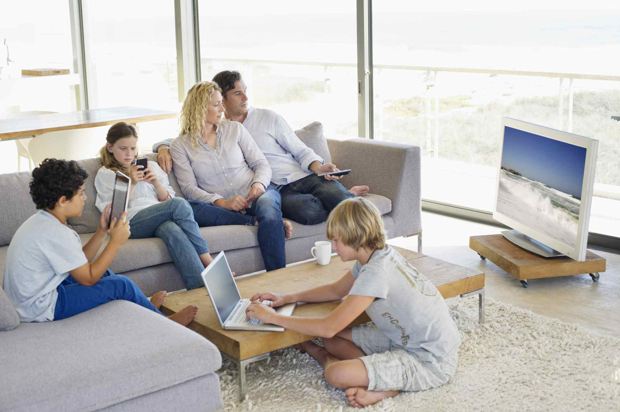 family with TV and technology