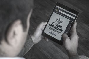 A man shopping on a tablet during Cyber Monday