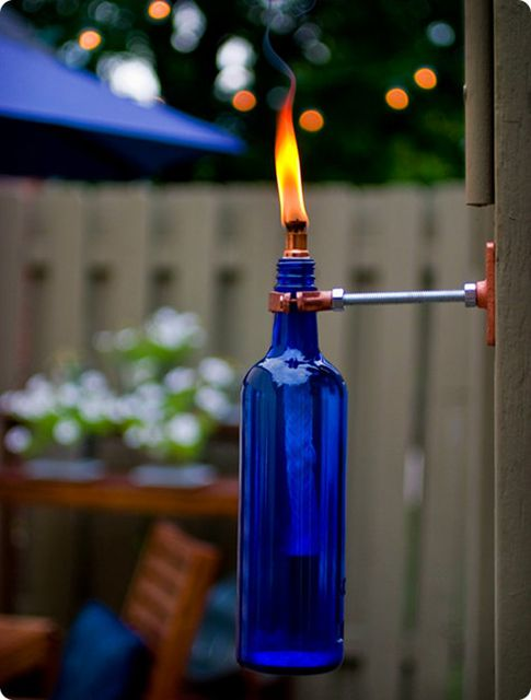 DIY outdoor decor - recycled wine bottle tiki torches