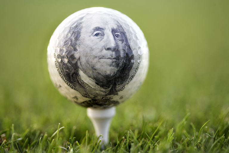 golf ball with Ben Franklin's image from the $100 bill