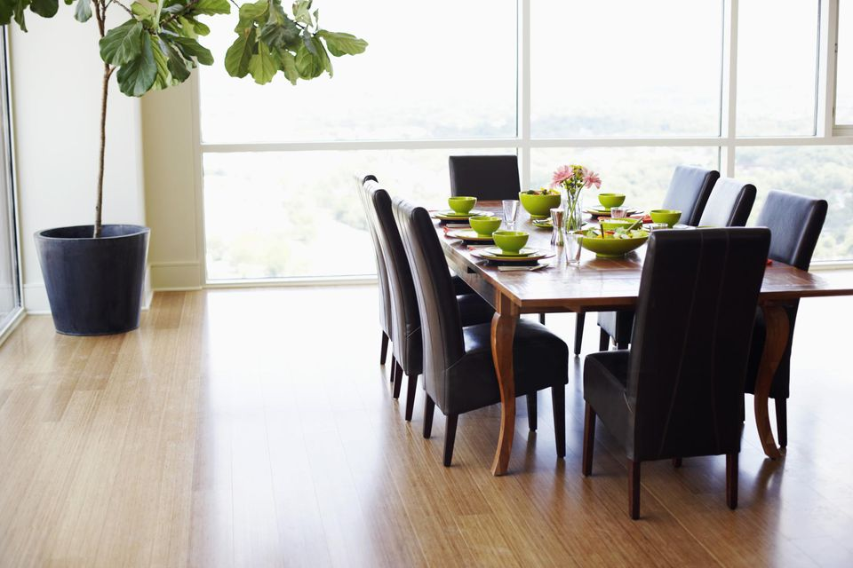 Dining table with empty chairs in a dining room