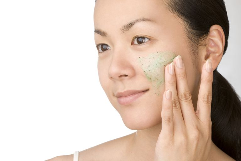 Japanese Woman using facial scrub on her face.