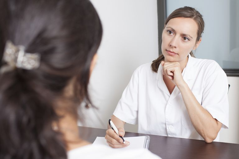 female health care professional talking to a patient