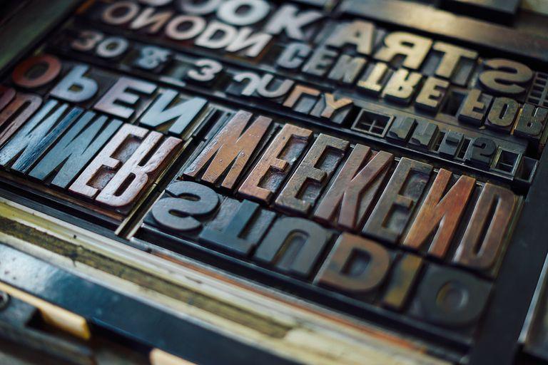 Detail shot of wooden letterpress letters in print workshop.