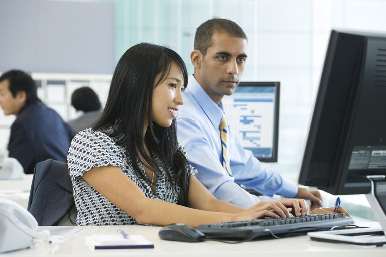 Woman and man working in large open modern office