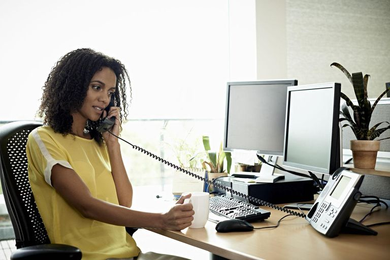 Confident businesswoman on the phone in a modern office