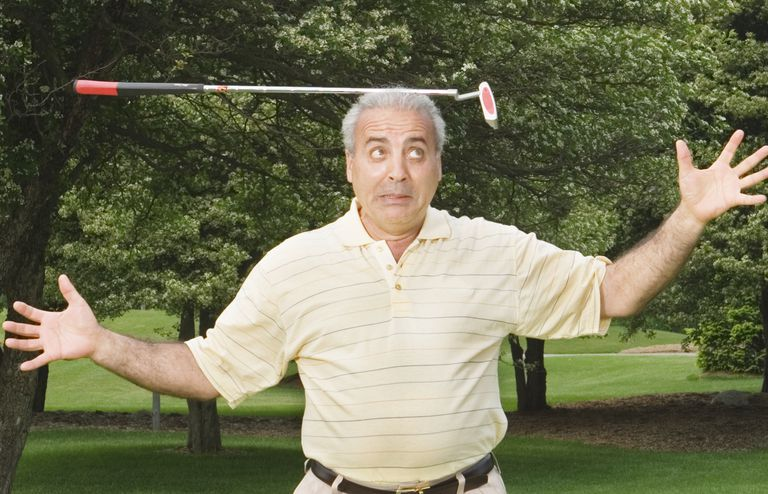 man balancing a putter on his head