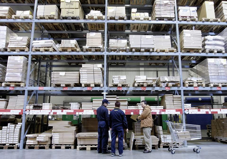 A shopper seeks assistance from IKEA employees