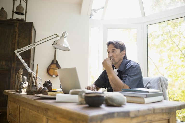 Man working at laptop at home
