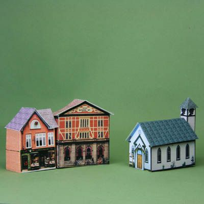 Printable miniature village church along with two printable miniature shops.