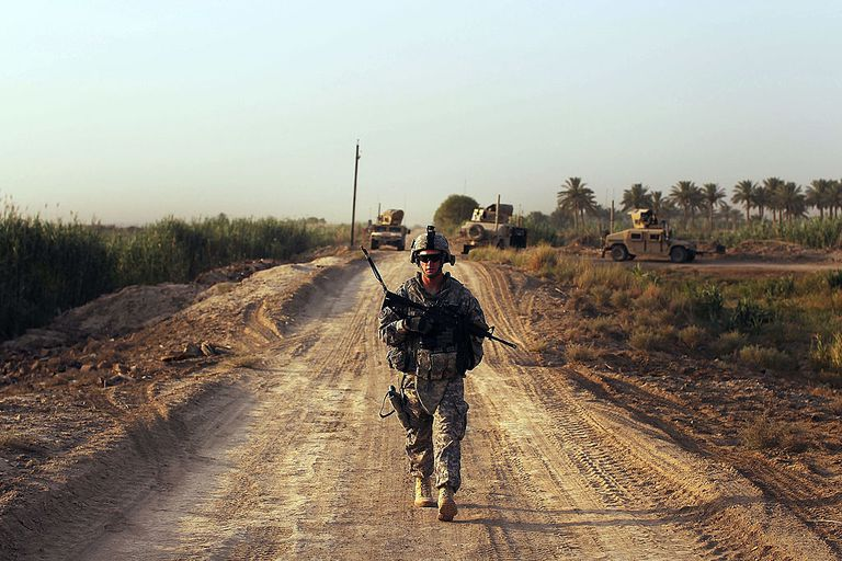 Lt. John Busch of Baytown, Texas with the 3rd Armored Cavalry Regiment walks on a patrol on July 13, 2011 in Iskandariya, Babil Province Iraq. As the deadline for the departure of the remaining American forces in Iraq approaches, Iraqi politicians have agreed to meet in two weeks time in order to give a final decision about extending the U.S. troops' presence beyond the end of the 2011 deadline. Violence against foreign troops has recently picked-up with June being the worst month in combat-related deaths for the military in Iraq in more than two years. Currently about 46,000 U.S. soldiers remain in Iraq.