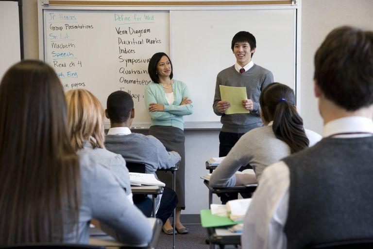 School boy giving presentation in class