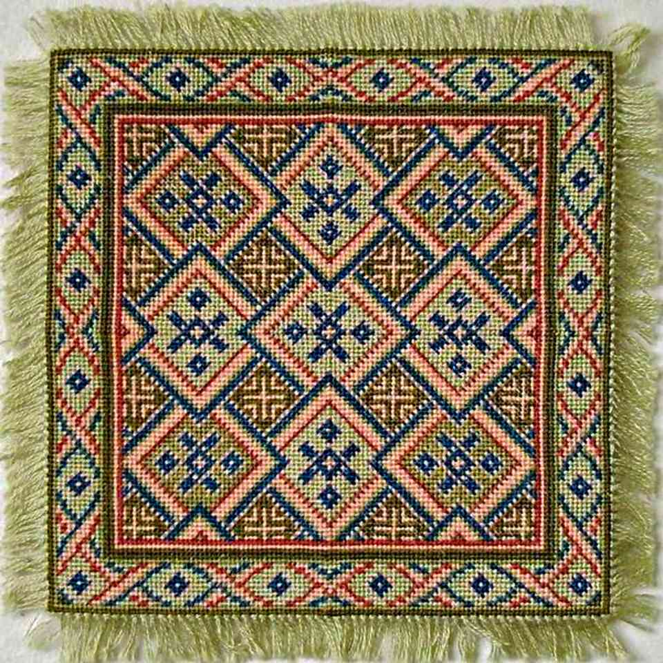 mini needlepoint rug in spring colors