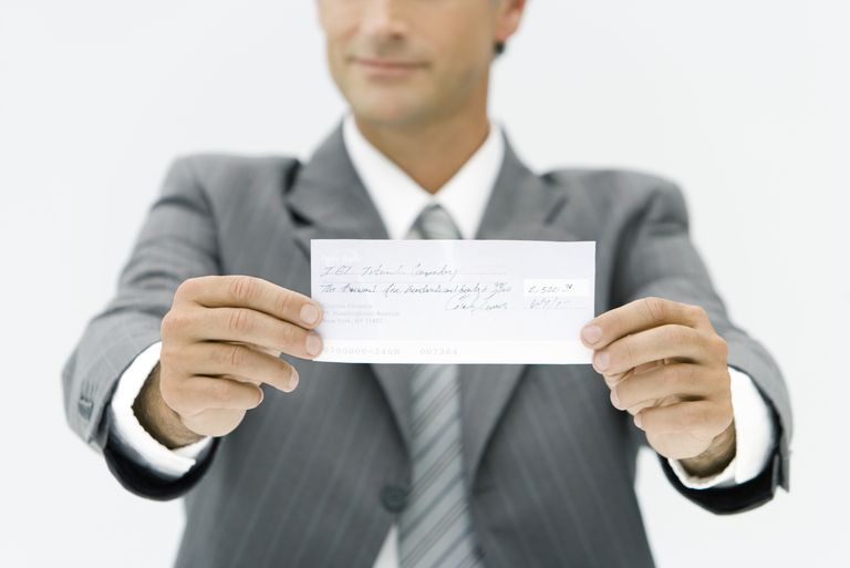 Man holding check.