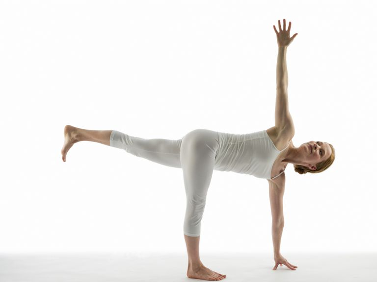Caucasian woman practicing yoga