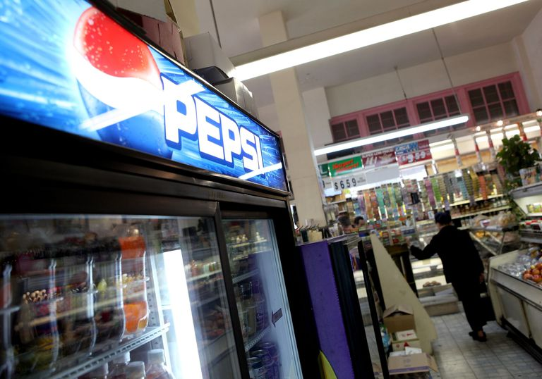 Selling Pepsi-Cola in a local store