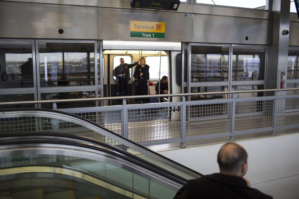 JFK Airport Passengers Ride the AirTrain