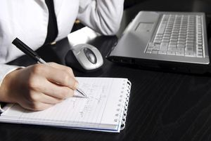 Businesswoman writing daily plan