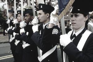 Junior ROTC members carrying flags