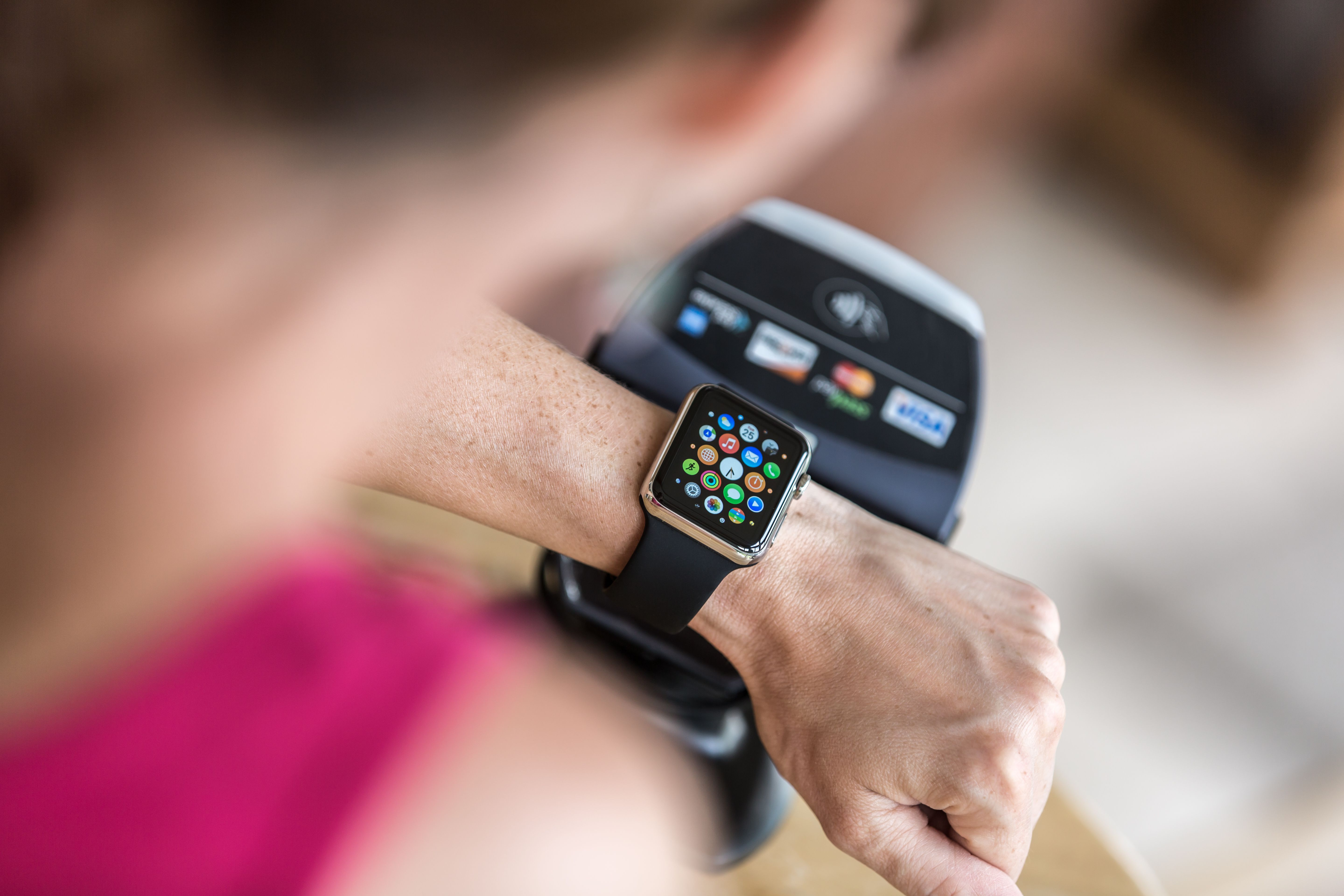 Woman Paying using Apple Watch and Electronic Reader
