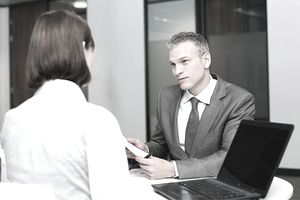 man and woman in business meeting