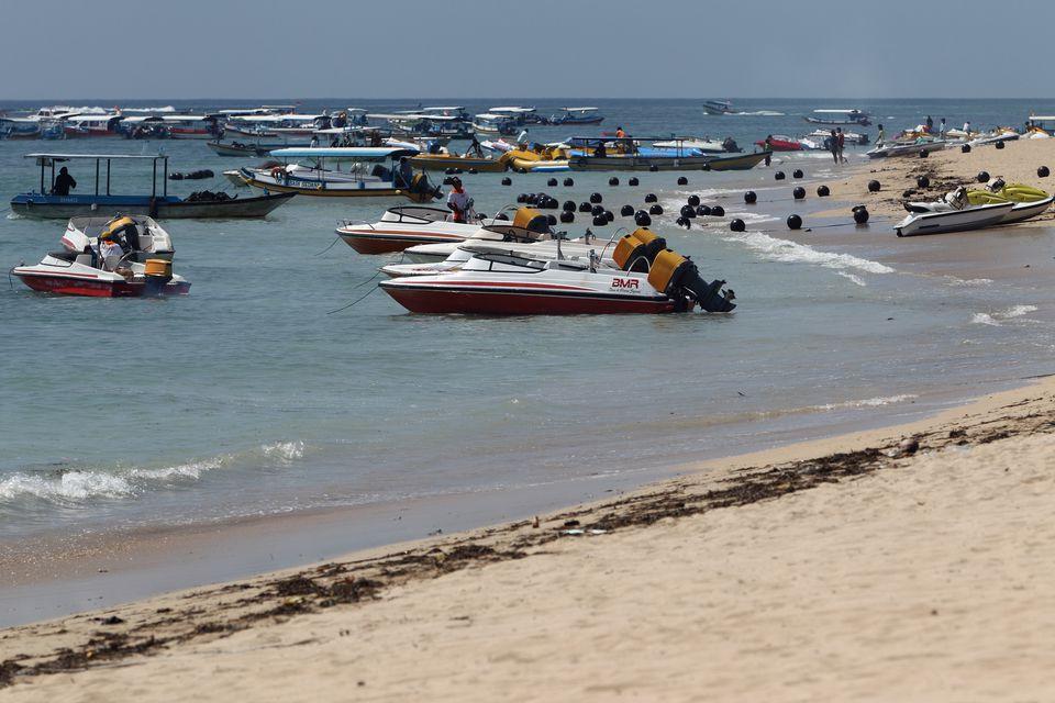 Boats at a beach in Tanjung Benoa