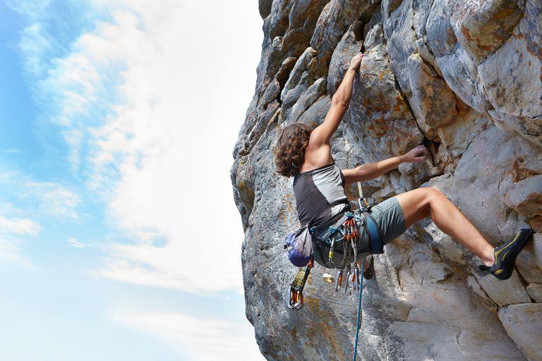 Woman Climbing a Mountain