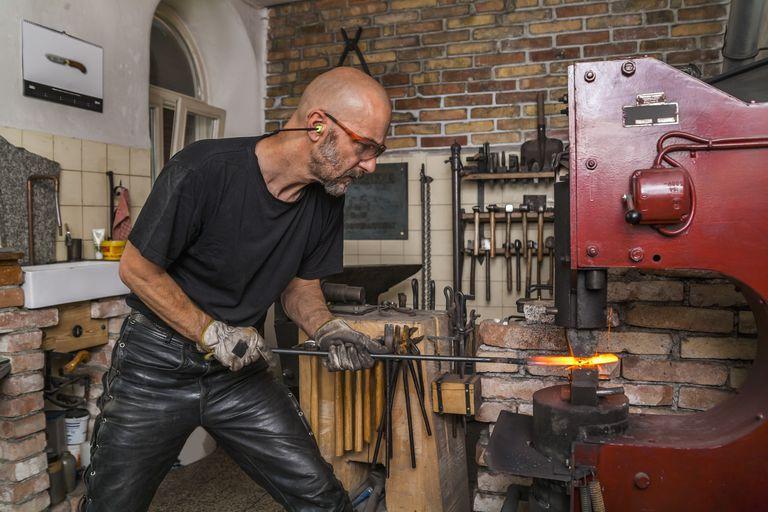 Knife maker in workshop at work