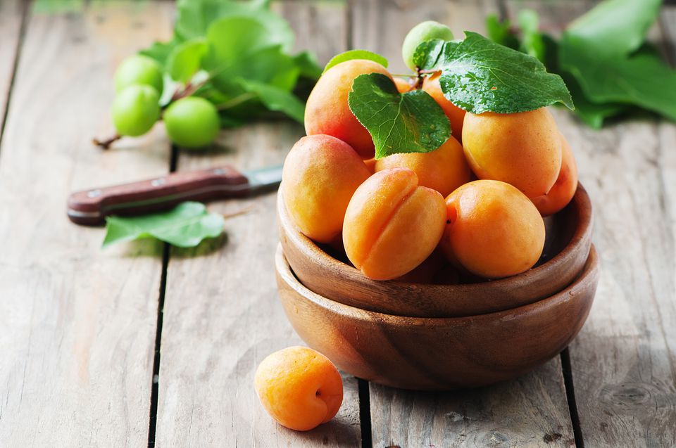 Fresh sweet apricots on the wooden table