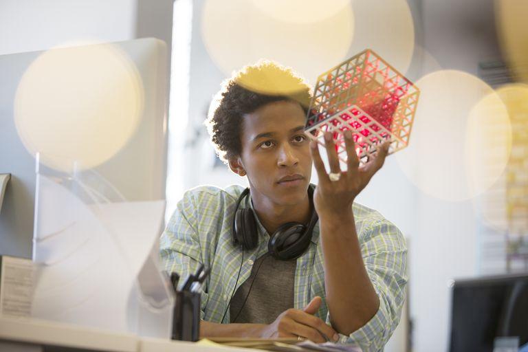 Young man examining cube