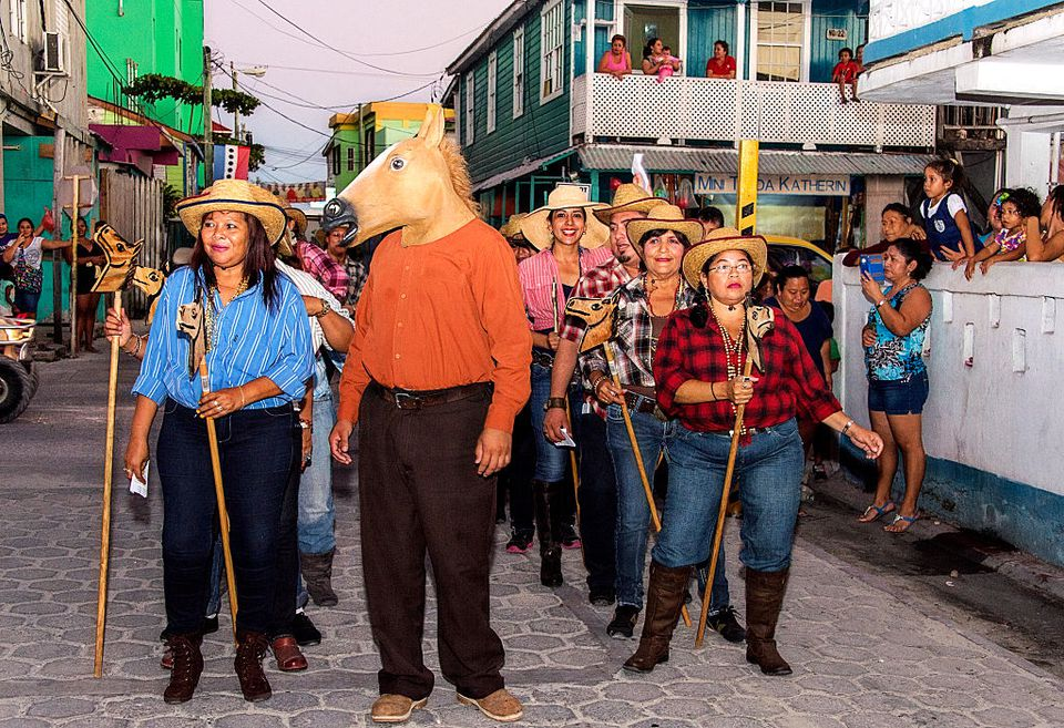 Carnival 2015! Carnival Comparsa group performs with singing and dancing on the streets of San Pedro, Belize on February 16, 2015