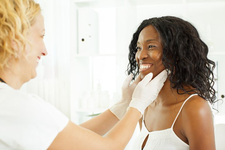 Mid Age African Woman Visit Doctor.