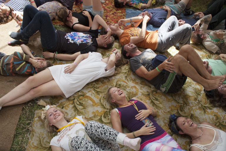 People laying on the floor laughing at a laughter yoga workshop