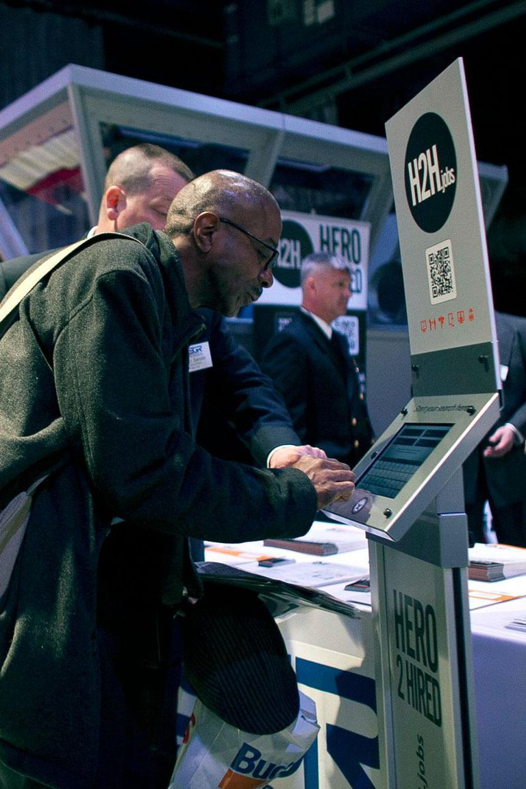 NEW YORK, NY - MARCH 28: A man uses a kiosk during a job fair for military veterans and spouses aboard the U.S.S. Intrepid Sea, Air, and Space Museum March 28, 2012 in New York City.