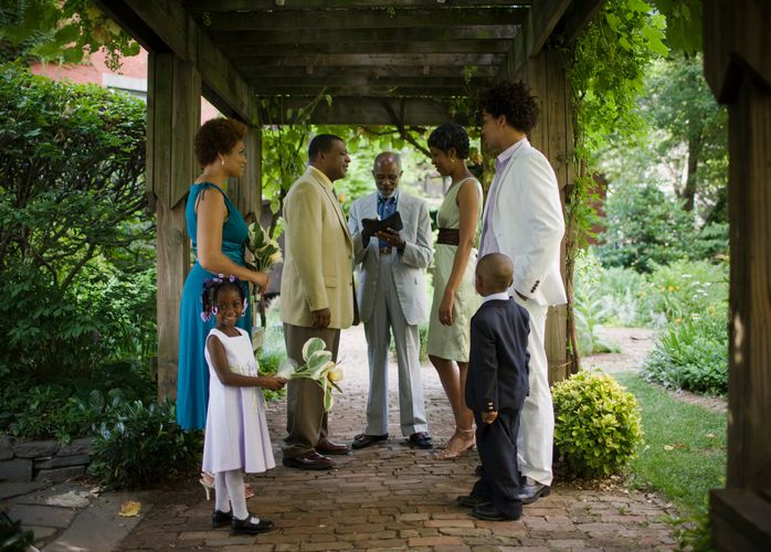Wedding ceremony at pergola including boy and girl (3-5)